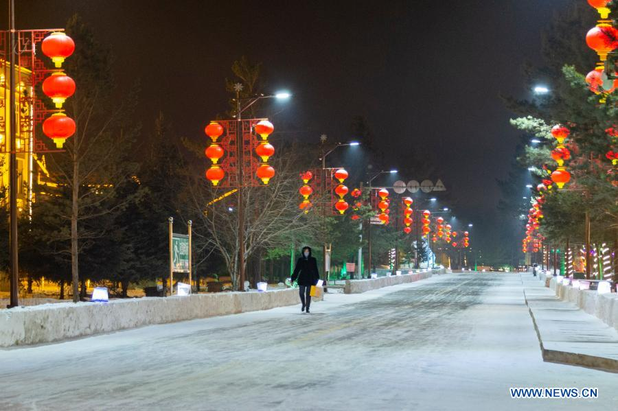 Photo taken on Jan. 12, 2021 shows the street lamps in Beiji Village of Mohe City, northeast China's Heilongjiang Province. Beiji Village, located in Mohe City, the northernmost city in China, could only rely on small diesel generators for power supply before 2007. After connecting to the State Grid, Beiji Village set up the northernmost power supply station in China, the Beiji Power Supply Station. Director Lyu Jiansheng and meter reader Wang Shaoting are the only two staff members of the station which is in charge of more than 20 kilometers of overhead lines and 70 kilometers of buried cable lines around it. The temperature in the village often drops to below minus 40 degrees Celsius, and they patrol along the line every once in a while. In 2020, the power supply station renovated multi-functional exhibition hall and canteen, purchased kitchenware and installed bathroom.