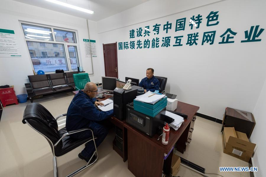 Lyu Jiansheng (R) and Wang Shaoting work at the office in Beiji Power Supply Station in Beiji Village of Mohe City, northeast China's Heilongjiang Province, Jan. 12, 2021. Beiji Village, located in Mohe City, the northernmost city in China, could only rely on small diesel generators for power supply before 2007. After connecting to the State Grid, Beiji Village set up the northernmost power supply station in China, the Beiji Power Supply Station. Director Lyu Jiansheng and meter reader Wang Shaoting are the only two staff members of the station which is in charge of more than 20 kilometers of overhead lines and 70 kilometers of buried cable lines around it. The temperature in the village often drops to below minus 40 degrees Celsius, and they patrol along the line every once in a while. In 2020, the power supply station renovated multi-functional exhibition hall and canteen, purchased kitchenware and installed bathroom.