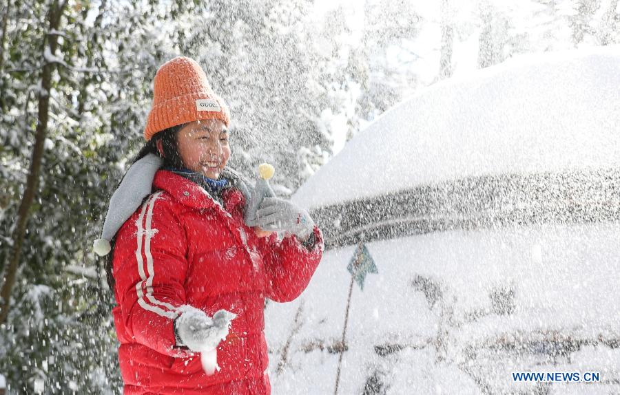 A student from Huchangbao Primary School plays with snow at a camp in Longcanggou National Forest Park in Yingjing County, southwest China's Sichuan Province, Jan. 13, 2021. Recent years Yingjing County has organized a series of educational activities in Longcanggou National Forest Park to boost local education in natural environment. (Xinhua/Jiang Hongjing)