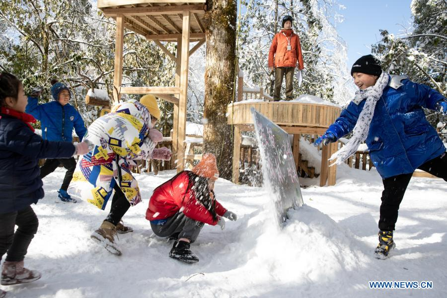 Students from Huchangbao Primary School have snow fight at a camp in Longcanggou National Forest Park in Yingjing County, southwest China's Sichuan Province, Jan. 13, 2021. Recent years Yingjing County has organized a series of educational activities in Longcanggou National Forest Park to boost local education in natural environment. (Xinhua/Jiang Hongjing)