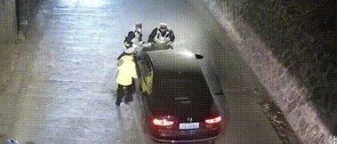 男子把交警顶上引擎盖逃逸后竟在单位里喝茶···