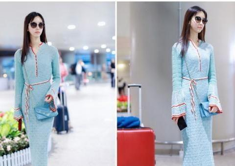 陈都灵一袭水蓝色丝质礼服,清爽优雅,举手投足间尽显女性魅力