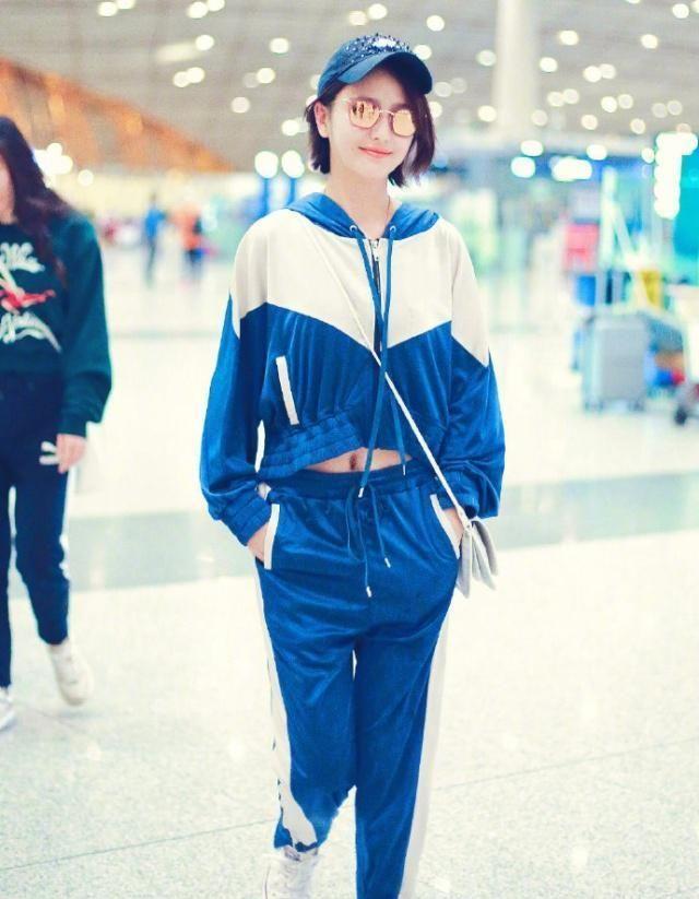 佟丽娅现身机场,一身蓝色校服秀细腰美回18岁,网友:少女本人!