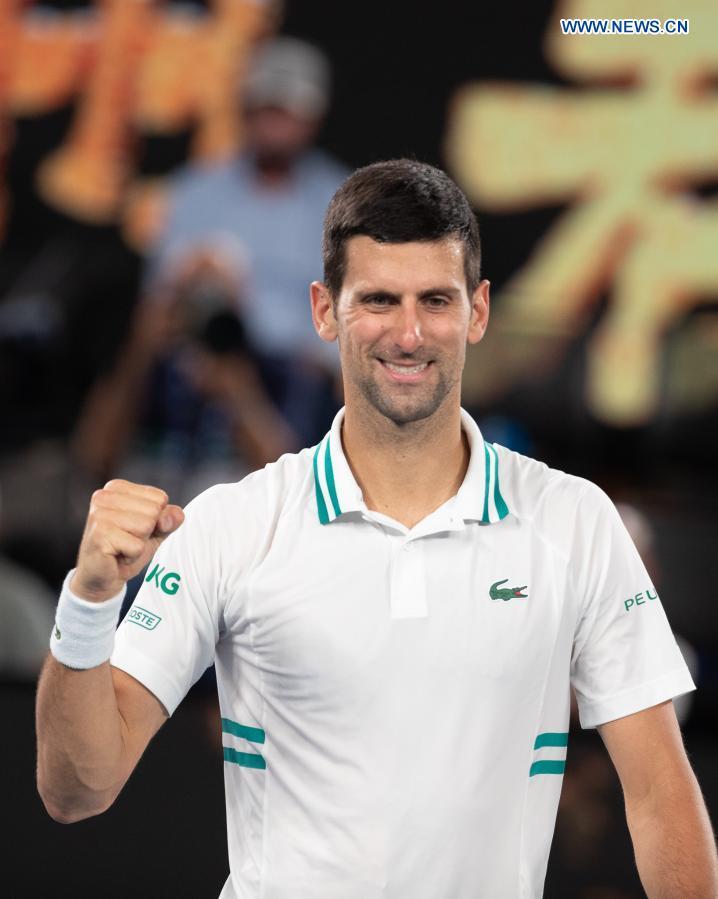 Serbia's Novak Djokovic celebrates after winning the men's singles semifinal between Serbia's Novak Djokovic and Russia's Aslan Karatsev at Australian Open in Melbourne Park in Melbourne, Australia, Feb. 18, 2021. (Photo by Hu Jingchen/Xinhua)