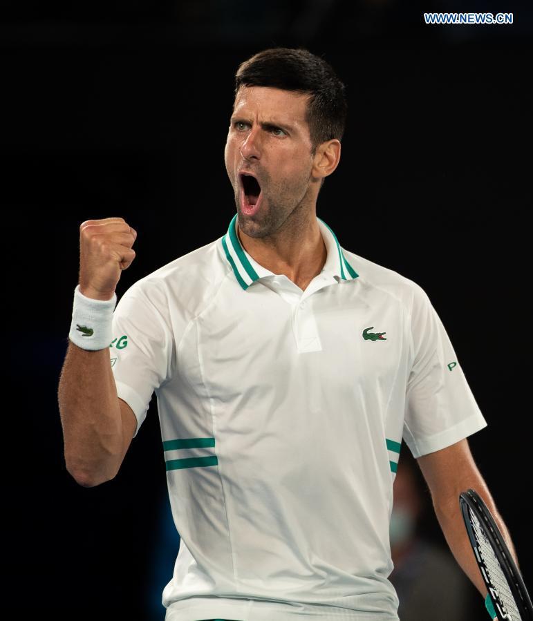 Serbia's Novak Djokovic celebrates during the men's singles semifinal between Serbia's Novak Djokovic and Russia's Aslan Karatsev at Australian Open in Melbourne Park in Melbourne, Australia, Feb. 18, 2021. (Photo by Hu Jingchen/Xinhua)