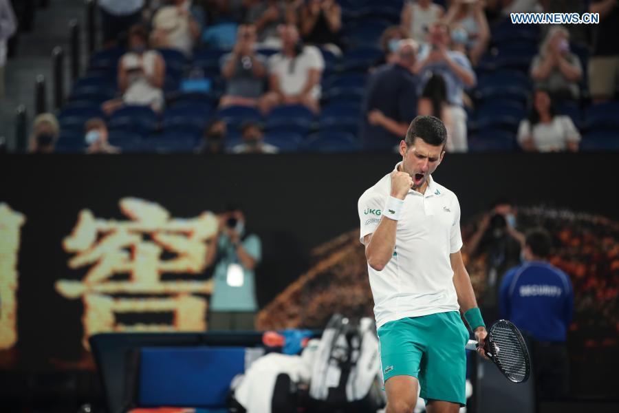 Serbia's Novak Djokovic celebrates after winning the men's singles semifinal between Serbia's Novak Djokovic and Russia's Aslan Karatsev at Australian Open in Melbourne Park in Melbourne, Australia, Feb. 18, 2021. (Xinhua/Bai Xuefei)