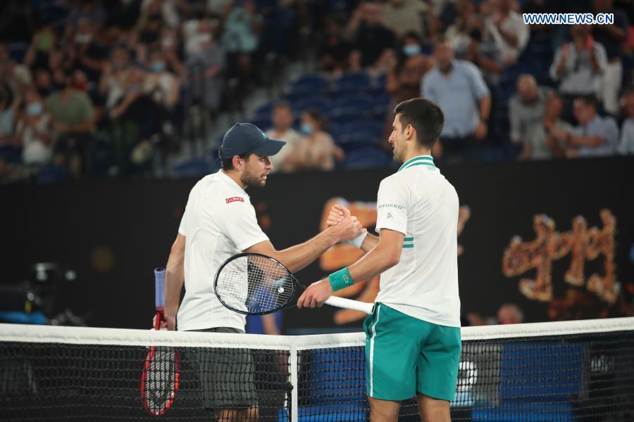 Novak Djokovic (R) shakes hands with Aslan Karatsev after the men's singles semifinal between Serbia's Novak Djokovic and Russia's Aslan Karatsev at Australian Open in Melbourne Park in Melbourne, Australia, Feb. 18, 2021. (Xinhua/Bai Xuefei)