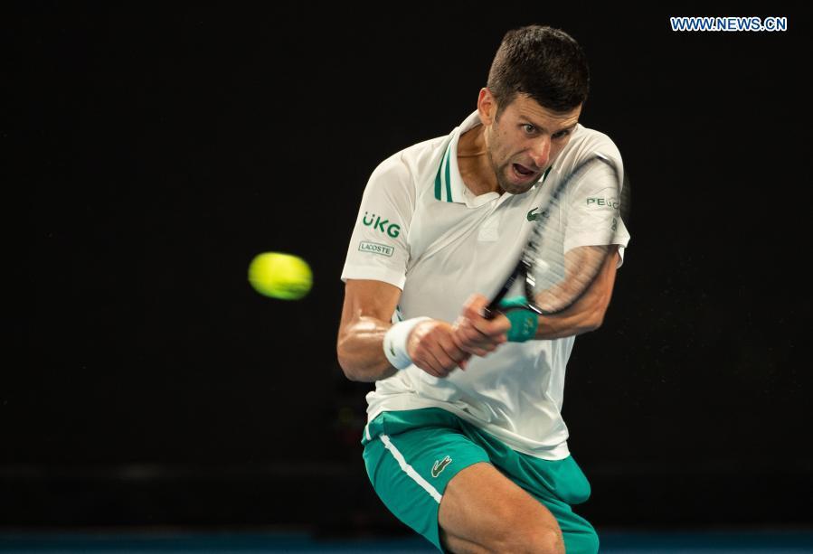 Serbia's Novak Djokovic competes during the men's singles semifinal between Serbia's Novak Djokovic and Russia's Aslan Karatsev at Australian Open in Melbourne Park in Melbourne, Australia, Feb. 18, 2021. (Photo by Hu Jingchen/Xinhua)