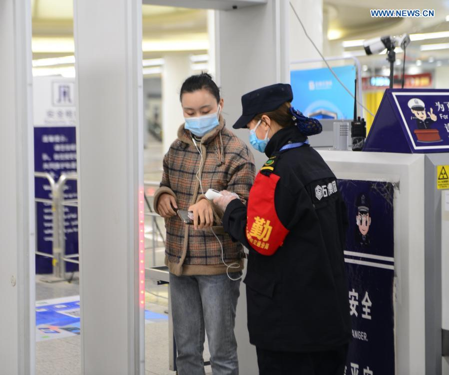 A passenger has her temperature checked at Beiguoshangcheng Station in Shijiazhuang, north China's Hebei Province, Feb. 19, 2021. Shijiazhuang resumed all-around subway operation with COVID-19 prevention measures on Friday. (Xinhua/Jin Haoyuan)