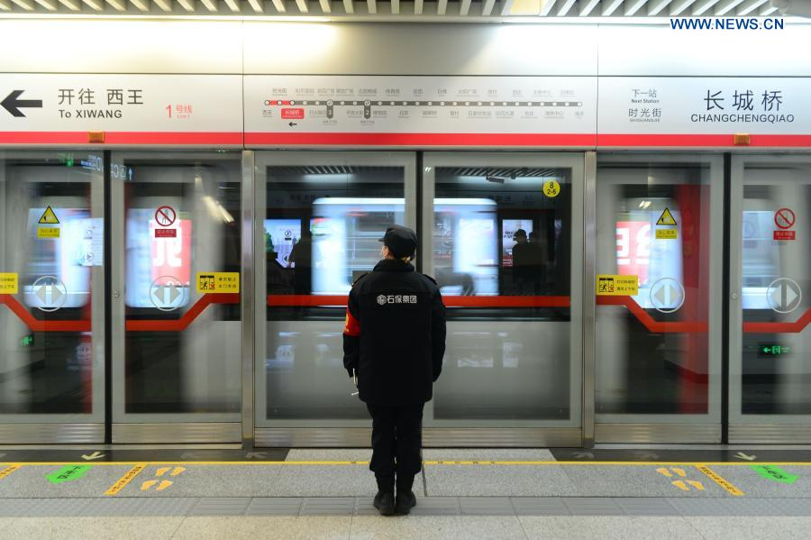 A staff member works at Changchengqiao Station in Shijiazhuang, north China's Hebei Province, Feb. 19, 2021. Shijiazhuang resumed all-around subway operation with COVID-19 prevention measures on Friday. (Xinhua/Jin Haoyuan)
