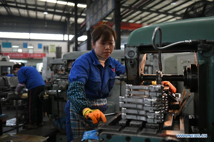Employees work at a machinery company in Mianzhu, southwest China's Sichuan Province, Feb. 18, 2021. Enterprises all over the country started operation again on Thursday as the Spring Festival holiday came to an end. (Photo by Wang Ping/Xinhua)
