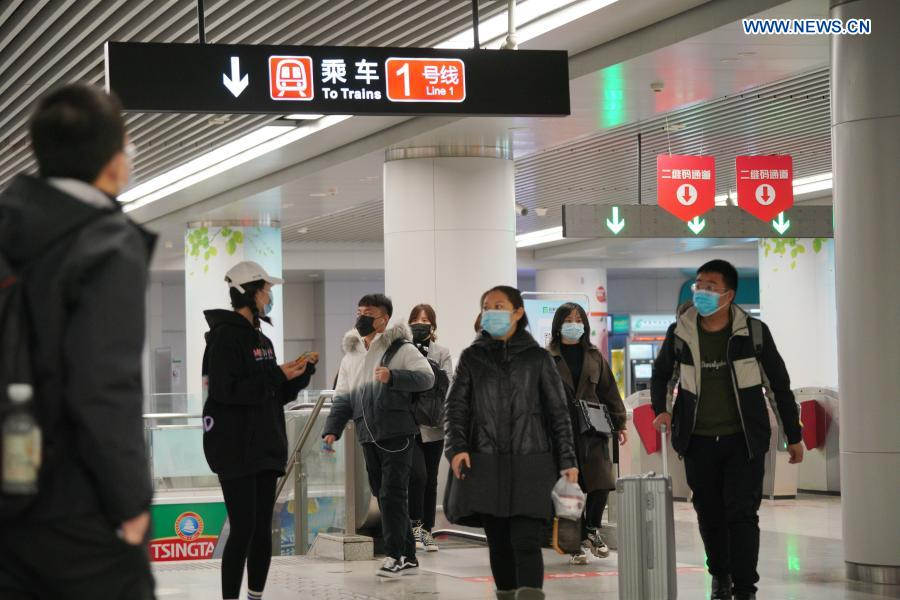 Passengers are seen at Xinbaiguangchang Station in Shijiazhuang, north China's Hebei Province, Feb. 19, 2021. Shijiazhuang resumed all-around subway operation with COVID-19 prevention measures on Friday. (Xinhua/Mu Yu)