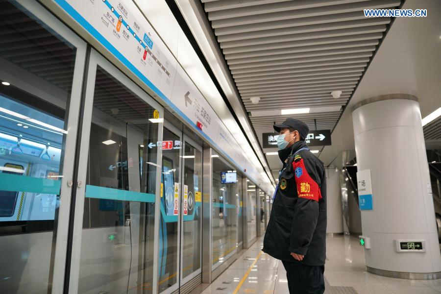 A staff member works at Xinbaiguangchang Station in Shijiazhuang, north China's Hebei Province, Feb. 19, 2021. Shijiazhuang resumed all-around subway operation with COVID-19 prevention measures on Friday. (Xinhua/Mu Yu)