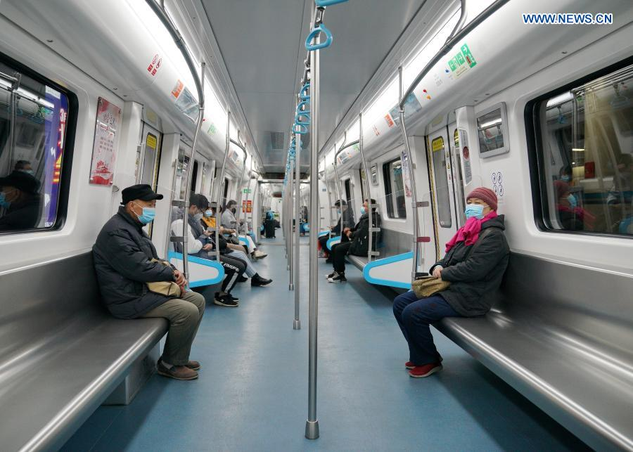 Passengers wearing face masks take a subway in Shijiazhuang, north China's Hebei Province, Feb. 19, 2021. Shijiazhuang resumed all-around subway operation with COVID-19 prevention measures on Friday. (Xinhua/Mu Yu)
