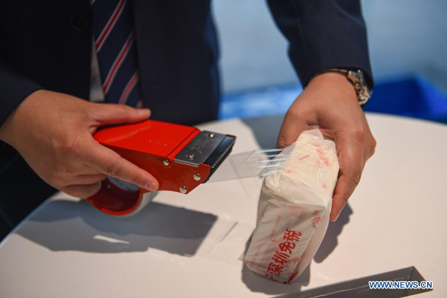 A staff member packs a piece of offshore duty-free good at a duty-free shopping mall in Haikou, south China's Hainan Province, Feb. 14, 2021. Offshore duty-free sales in China's island province of Hainan reached 997 million yuan (about 154.4 million U.S. dollars) during the 2021 Spring Festival holiday, an increase of 261 percent year on year, according to the data from Haikou Customs. (Xinhua/Pu Xiaoxu)