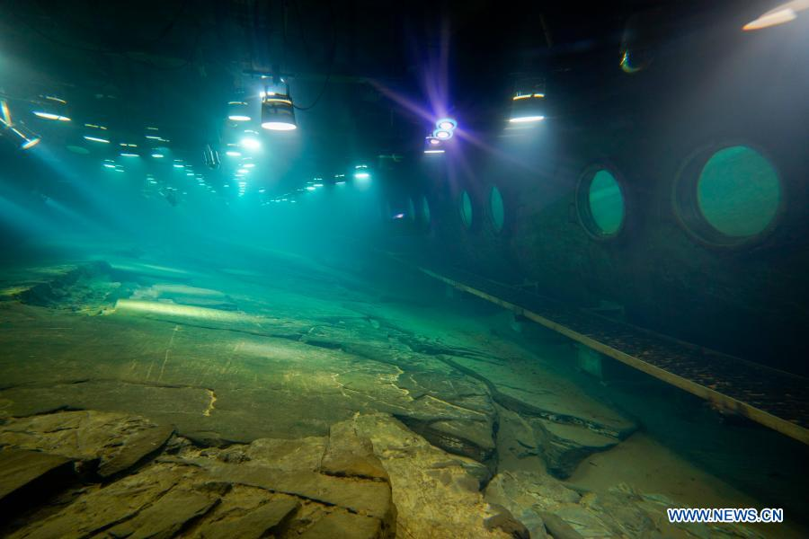 Photo taken on Feb. 21, 2021 shows the protected reef created about 1,200 years ago to measure the changes in water levels at Baiheliang Museum, China's first underwater museum built about 40 meters below surface in the upper reaches of the Yangtze River off the coast of Fuling City, southwest China's Chongqing Municipality. Baiheliang Museum reopened to public recently after a four-month renovation. Baiheliang, literally