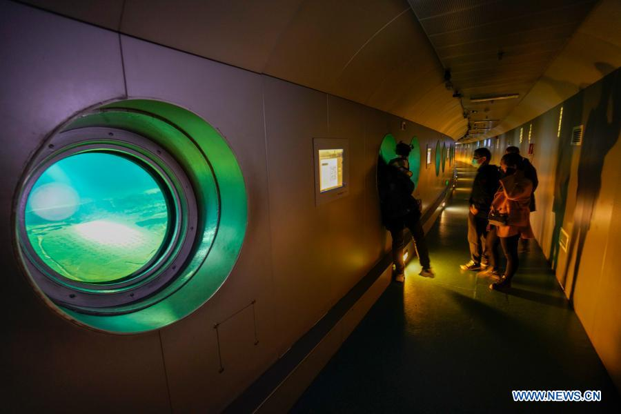 People visit Baiheliang Museum, China's first underwater museum built about 40 meters below surface in the upper reaches of the Yangtze River off the coast of Fuling City, southwest China's Chongqing Municipality, Feb. 21, 2021. Baiheliang Museum reopened to public recently after a four-month renovation. Baiheliang, literally