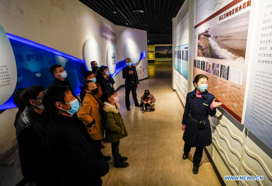 People visit an on-land exhibition room of Baiheliang Museum, China's first underwater museum built about 40 meters below surface in the upper reaches of the Yangtze River off the coast of Fuling City, southwest China's Chongqing Municipality, Feb. 21, 2021. Baiheliang Museum reopened to public recently after a four-month renovation. Baiheliang, literally