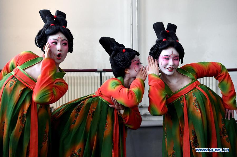 Dancers practice at Zhengzhou Song and Dance Theater in Zhengzhou, central China's Henan Province, Feb. 20, 2021. Fourteen dancers from Zhengzhou Song and Dance Theater have been very busy since the dancing they performed went viral online. The performance, named Banquet of Tang Palace, was staged at the Spring Festival gala of Henan Province. Brilliantly choreographed and acted, the dancing has almost brought ancient dancing figurines of the Tang Dynasty (618-907) alive. The performance Banquet of Tang Palace, inspired by the dancing figurines displayed at a museum, tells a story about the life of female musicians during the Tang Dynasty.
