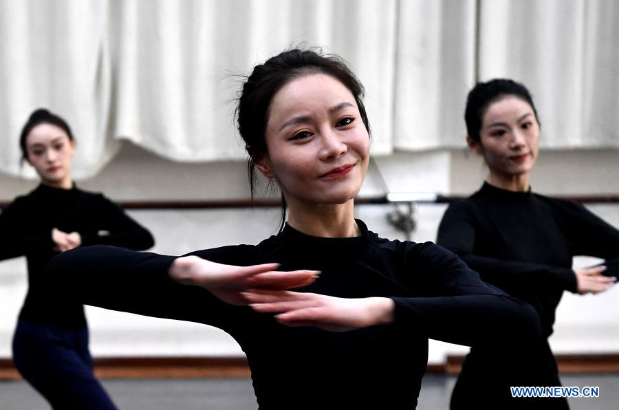 Yi Xingyan (C), leading actress of Zhengzhou Song and Dance Theater, practices at the theater in Zhengzhou, central China's Henan Province, Feb. 20, 2021. Fourteen dancers from Zhengzhou Song and Dance Theater have been very busy since the dancing they performed went viral online. The performance, named Banquet of Tang Palace, was staged at the Spring Festival gala of Henan Province. Brilliantly choreographed and acted, the dancing has almost brought ancient dancing figurines of the Tang Dynasty (618-907) alive. The performance Banquet of Tang Palace, inspired by the dancing figurines displayed at a museum, tells a story about the life of female musicians during the Tang Dynasty.