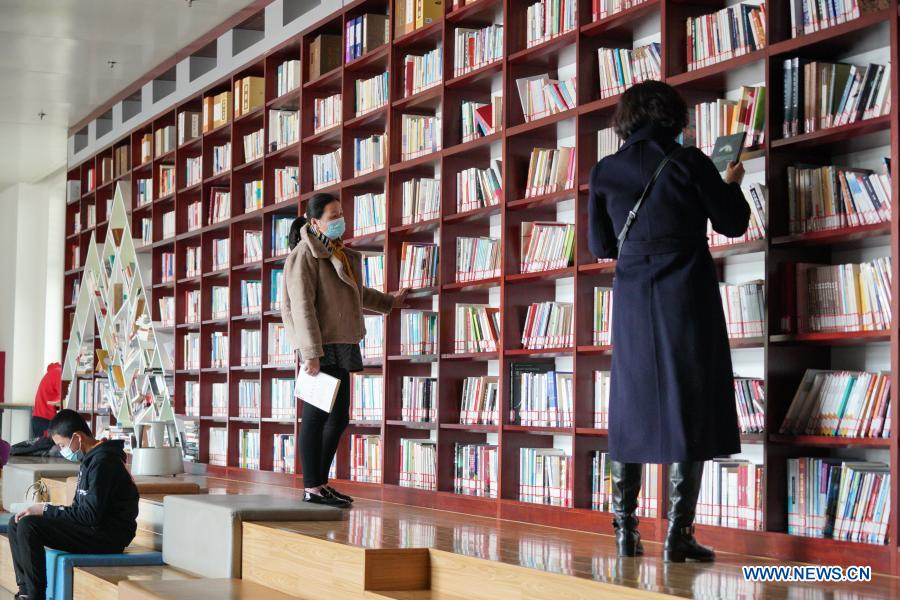 People select books at Hebei Provincial Library in Shijiazhuang, north China's Hebei Province, Feb. 22, 2021. Public cultural venues and stadiums in the northern Chinese city of Shijiazhuang, hit by a recent COVID-19 resurgence, resumed operation on Monday. Shijiazhuang cleared all medium- and high-risk areas for COVID-19 on Monday. (Xinhua/Mu Yu)