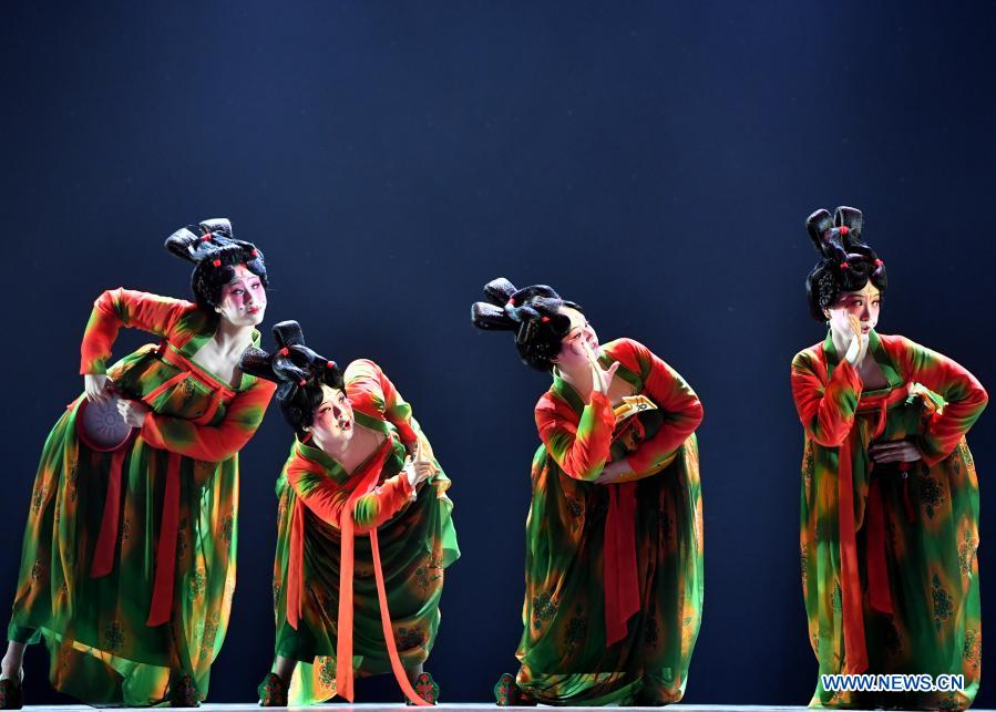 Dancers perform Banquet of Tang Palace during the finals of Lotus Awards in Luoyang, central China's Henan Province, Oct. 16, 2020. Fourteen dancers from Zhengzhou Song and Dance Theater have been very busy since the dancing they performed went viral online. The performance, named Banquet of Tang Palace, was staged at the Spring Festival gala of Henan Province. Brilliantly choreographed and acted, the dancing has almost brought ancient dancing figurines of the Tang Dynasty (618-907) alive. The performance Banquet of Tang Palace, inspired by the dancing figurines displayed at a museum, tells a story about the life of female musicians during the Tang Dynasty.