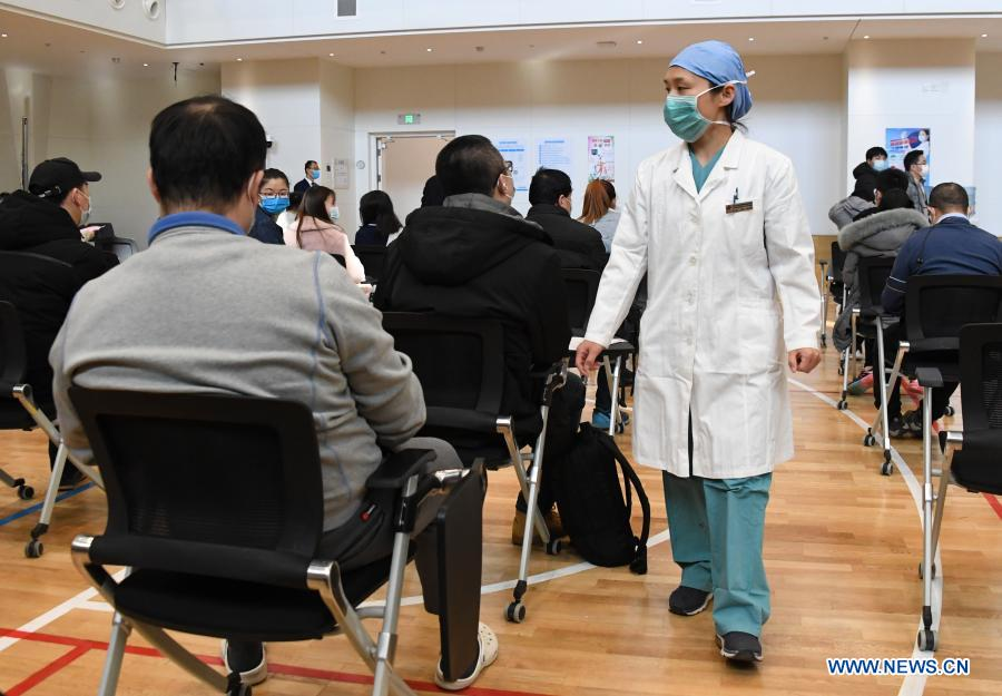A medical worker works at a temporary COVID-19 vaccination site at a company in the ZPark Phase 2 in Haidian District of Beijing, capital of China, Feb. 22, 2021. It is expected to take two days to complete the vaccination of more than 3,800 employees of the enterprise. (Xinhua/Ren Chao)