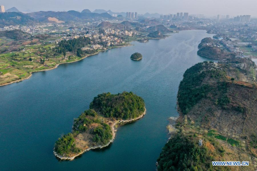 Aerial photo taken on Feb. 24, 2021 shows a view of the Aha Lake National Wetland Park in Guiyang, southwest China's Guizhou Province. (Xinhua/Ou Dongqu)