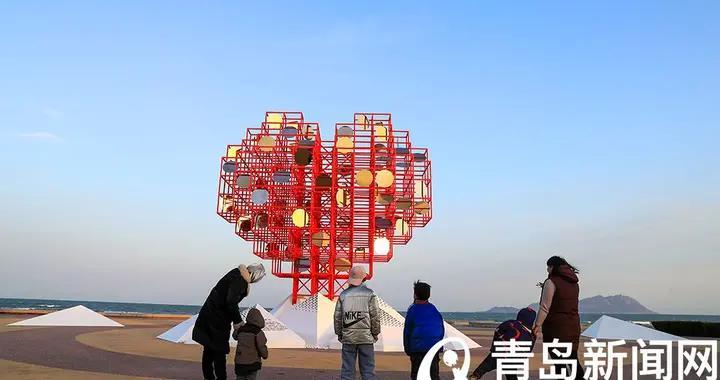 """""""山海情深爱心汇聚""""西海岸城市阳台这座新雕塑你打卡了吗"""