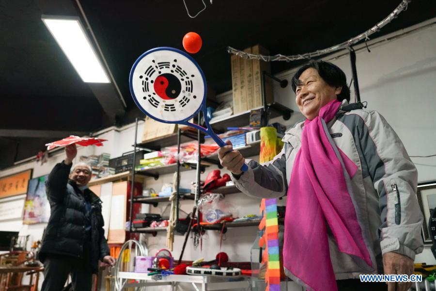 Customers try toys at a toy shop for the elderly in Beijing, capital of China, Feb. 23, 2021. The toy shop owned by Song Delong, which has about 400 kinds of toys especially for the elderly people, serves not only as a toy shop but a popular leisure and social place for local seniors. (Xinhua/Chen Zhonghao)