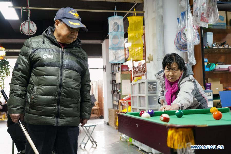 Elderly people play billiards at a toy shop for the elderly in Beijing, capital of China, Feb. 23, 2021. The toy shop owned by Song Delong, which has about 400 kinds of toys especially for the elderly people, serves not only as a toy shop but a popular leisure and social place for local seniors. (Xinhua/Chen Zhonghao)