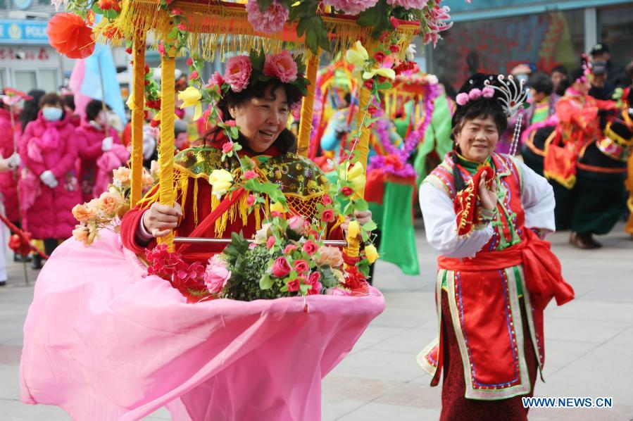 Local artists perform to celebrate the Lantern Festival in Lianyungang, east China's Jiangsu Province, Feb. 26, 2021. Various activities were held across China to celebrate the Lantern Festival on Friday, the 15th day of the first month of the Chinese lunar calendar. (Photo by Wang Chun/Xinhua)