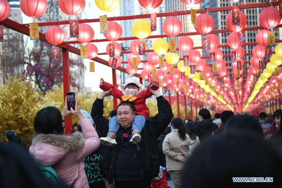 People pose for photos in Shenyang, capital of northeast China's Liaoning Province, Feb. 26, 2021. Various activities were held across China to celebrate the Lantern Festival on Friday, the 15th day of the first month of the Chinese lunar calendar. (Xinhua/Cai Xiangxin)