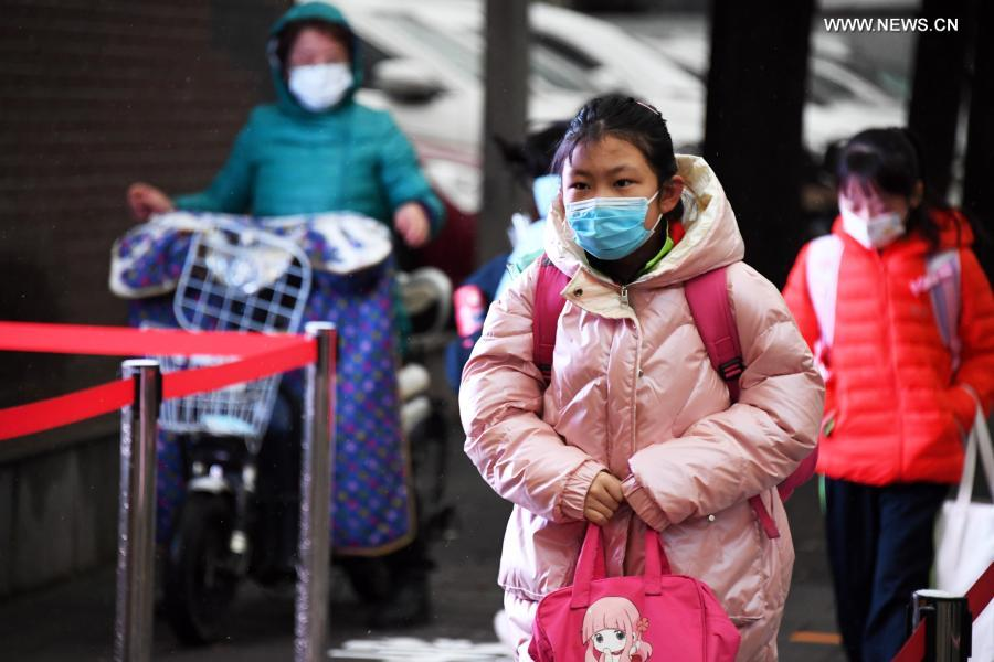 Students walk into the campus of Beijing Taipinglu Primary school in Haidian District of Beijing, capital of China, March 1, 2021. Middle school and primary school students returned to school as scheduled for the spring semester in Beijing on Monday amid coordinated epidemic control efforts. (Xinhua/Ren Chao)
