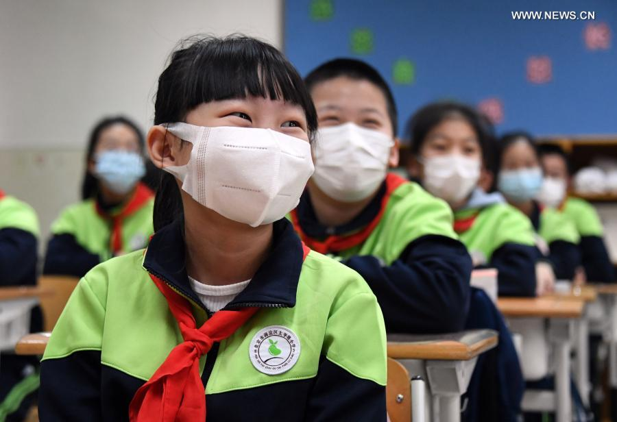 Students have class at Beijing Taipinglu Primary school in Haidian District of Beijing, capital of China, March 1, 2021. Middle school and primary school students returned to school as scheduled for the spring semester in Beijing on Monday amid coordinated epidemic control efforts. (Xinhua/Ren Chao)