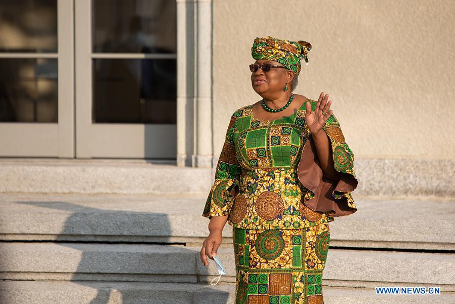 Ngozi Okonjo-Iweala waves upon her arrival at the World Trade Organization headquarters in Geneva, Switzerland, on March 1, 2021. The World Trade Organization's first female and first African Director General, Ngozi Okonjo-Iweala, officially took office on Monday, ending a six-month