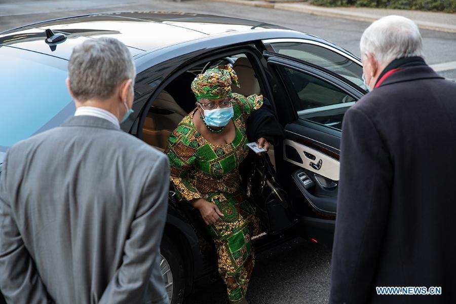 Ngozi Okonjo-Iweala (C) arrives at the World Trade Organization headquarters in Geneva, Switzerland, on March 1, 2021. The World Trade Organization's first female and first African Director General, Ngozi Okonjo-Iweala, officially took office on Monday, ending a six-month