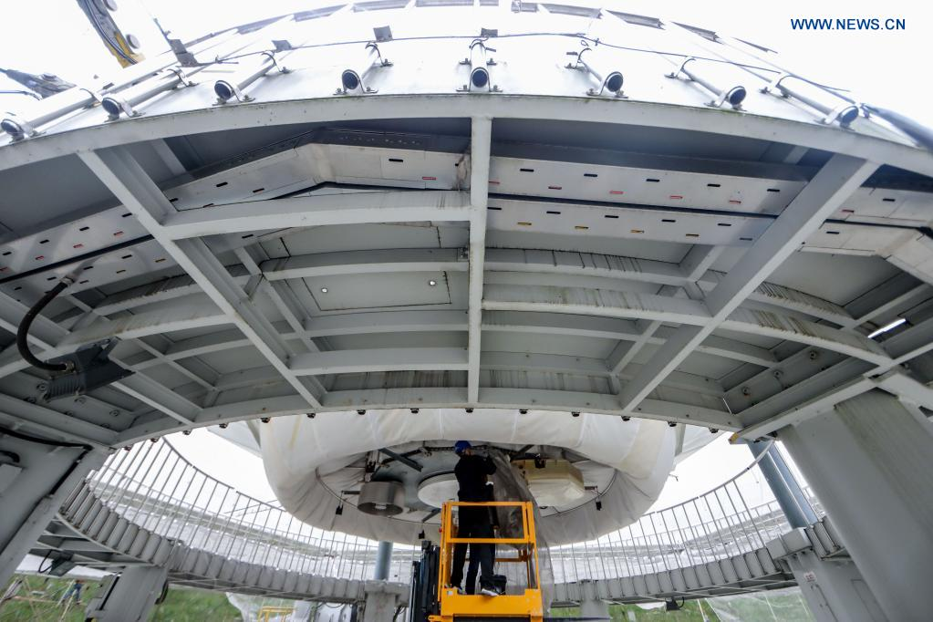 A staff member works on the feed cabin during a regular maintenance operation to the Five-hundred-meter Aperture Spherical Radio Telescope (FAST) in Pingtang County, southwest China's Guizhou Province, March 28, 2021. Starting formal operations in Jan. 11, 2020, the FAST is believed to be the largest and most sensitive radio telescope in the world, which has a huge potential for verifying and exploring mysteries of the universe. (Xinhua/Ou Dongqu)