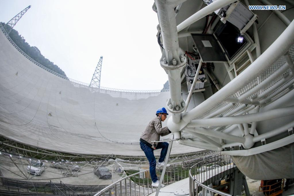 A staff member enters the feed cabin during a regular maintenance operation to the Five-hundred-meter Aperture Spherical Radio Telescope (FAST) in Pingtang County, southwest China's Guizhou Province, March 28, 2021. Starting formal operations in Jan. 11, 2020, the FAST is believed to be the largest and most sensitive radio telescope in the world, which has a huge potential for verifying and exploring mysteries of the universe. (Xinhua/Ou Dongqu)
