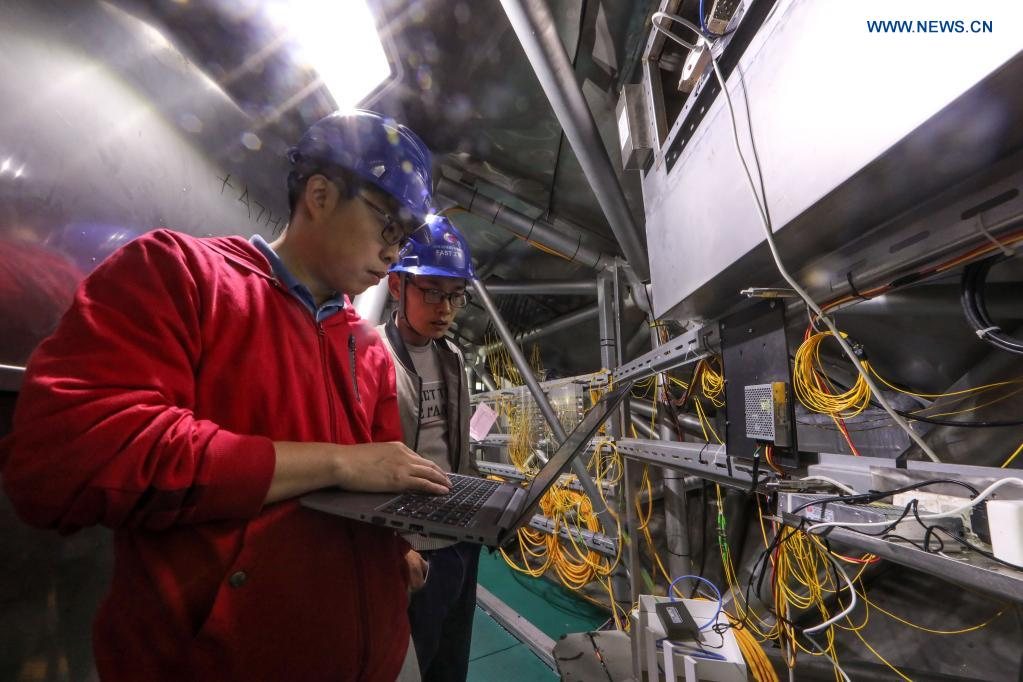 Staff members work on the feed cabin during a regular maintenance operation to the Five-hundred-meter Aperture Spherical Radio Telescope (FAST) in Pingtang County, southwest China's Guizhou Province, March 28, 2021. Starting formal operations in Jan. 11, 2020, the FAST is believed to be the largest and most sensitive radio telescope in the world, which has a huge potential for verifying and exploring mysteries of the universe. (Xinhua/Ou Dongqu)
