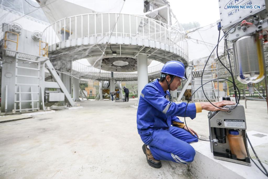 A staff member works during a regular maintenance operation to the Five-hundred-meter Aperture Spherical Radio Telescope (FAST) in Pingtang County, southwest China's Guizhou Province, March 28, 2021. Starting formal operations in Jan. 11, 2020, the FAST is believed to be the largest and most sensitive radio telescope in the world, which has a huge potential for verifying and exploring mysteries of the universe. (Xinhua/Ou Dongqu)