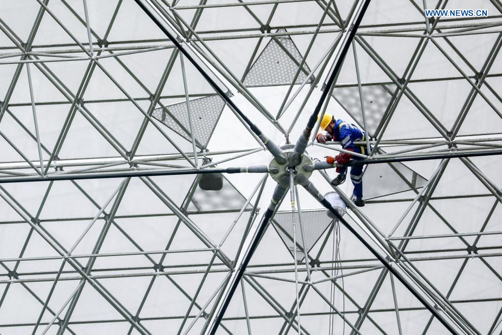 A staff member checks reflector panels during a regular maintenance operation to the Five-hundred-meter Aperture Spherical Radio Telescope (FAST) in Pingtang County, southwest China's Guizhou Province, March 28, 2021. Starting formal operations in Jan. 11, 2020, the FAST is believed to be the largest and most sensitive radio telescope in the world, which has a huge potential for verifying and exploring mysteries of the universe. (Xinhua/Ou Dongqu)