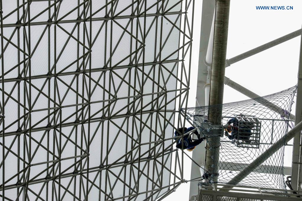 Staff members check the reflector panels during a regular maintenance operation to the Five-hundred-meter Aperture Spherical Radio Telescope (FAST) in Pingtang County, southwest China's Guizhou Province, March 28, 2021. Starting formal operations in Jan. 11, 2020, the FAST is believed to be the largest and most sensitive radio telescope in the world, which has a huge potential for verifying and exploring mysteries of the universe. (Xinhua/Ou Dongqu)