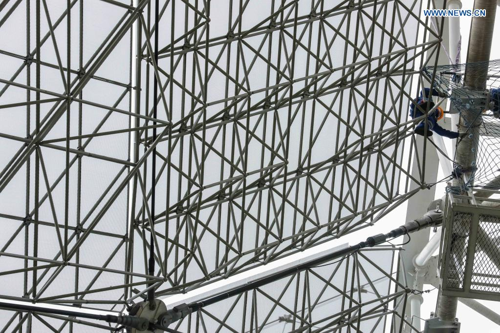 A staff member checks the reflector panels during a regular maintenance operation to the Five-hundred-meter Aperture Spherical Radio Telescope (FAST) in Pingtang County, southwest China's Guizhou Province, March 28, 2021. Starting formal operations in Jan. 11, 2020, the FAST is believed to be the largest and most sensitive radio telescope in the world, which has a huge potential for verifying and exploring mysteries of the universe. (Xinhua/Ou Dongqu)
