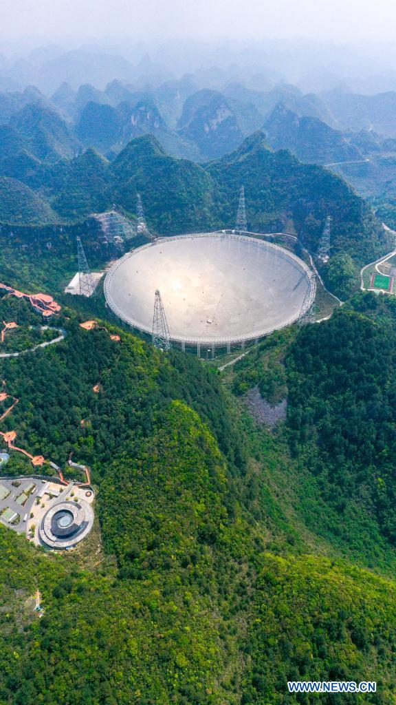 Aerial photo taken on March 29, 2021 shows China's Five-hundred-meter Aperture Spherical Radio Telescope (FAST) under maintenance in southwest China's Guizhou Province. China's FAST officially opened to the world starting Wednesday. (Xinhua/Ou Dongqu)