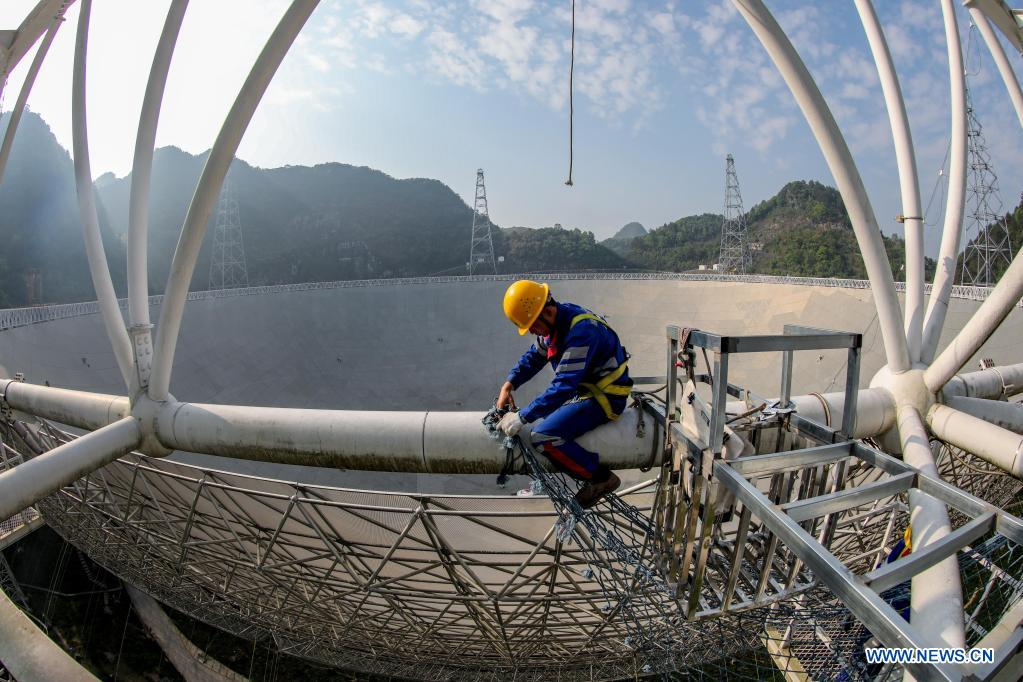 A staff member maintains China's Five-hundred-meter Aperture Spherical Radio Telescope (FAST) in southwest China's Guizhou Province, March 29, 2021. China's FAST officially opened to the world starting Wednesday. (Xinhua/Ou Dongqu)