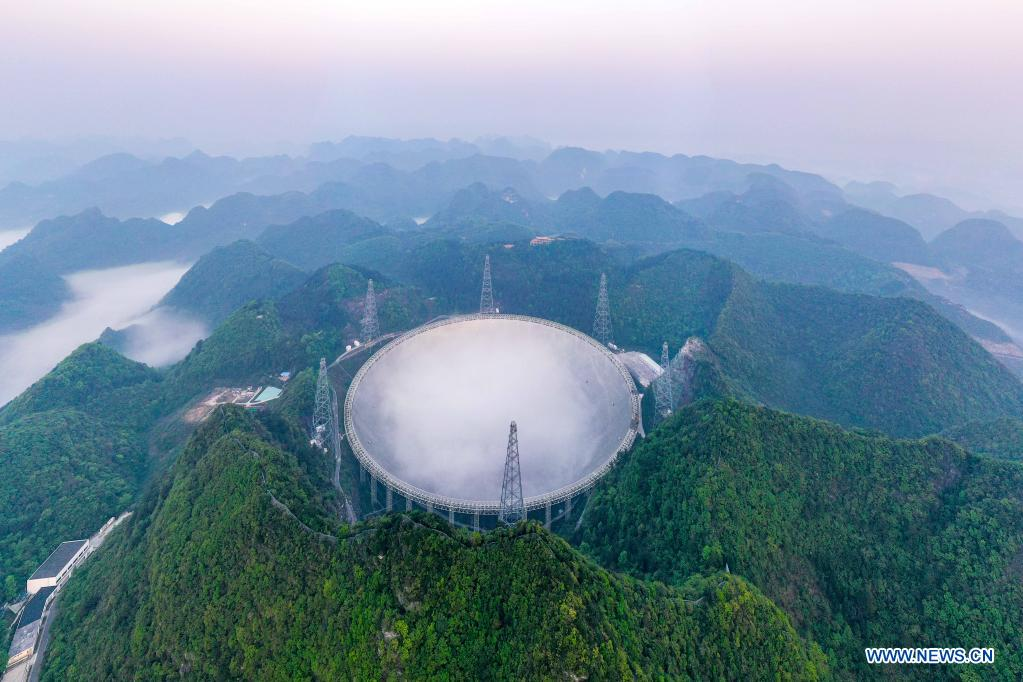 Aerial photo taken on March 31, 2021 shows China's Five-hundred-meter Aperture Spherical Radio Telescope (FAST) under maintenance in southwest China's Guizhou Province. China's FAST officially opened to the world starting Wednesday. (Xinhua/Ou Dongqu)