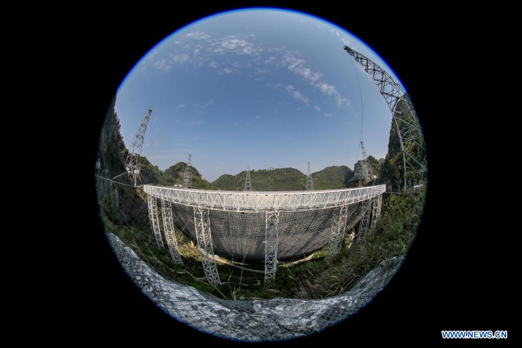 Panoramic photo taken on March 29, 2021 shows China's Five-hundred-meter Aperture Spherical Radio Telescope (FAST) under maintenance in southwest China's Guizhou Province. China's FAST officially opened to the world starting Wednesday. (Xinhua/Ou Dongqu)