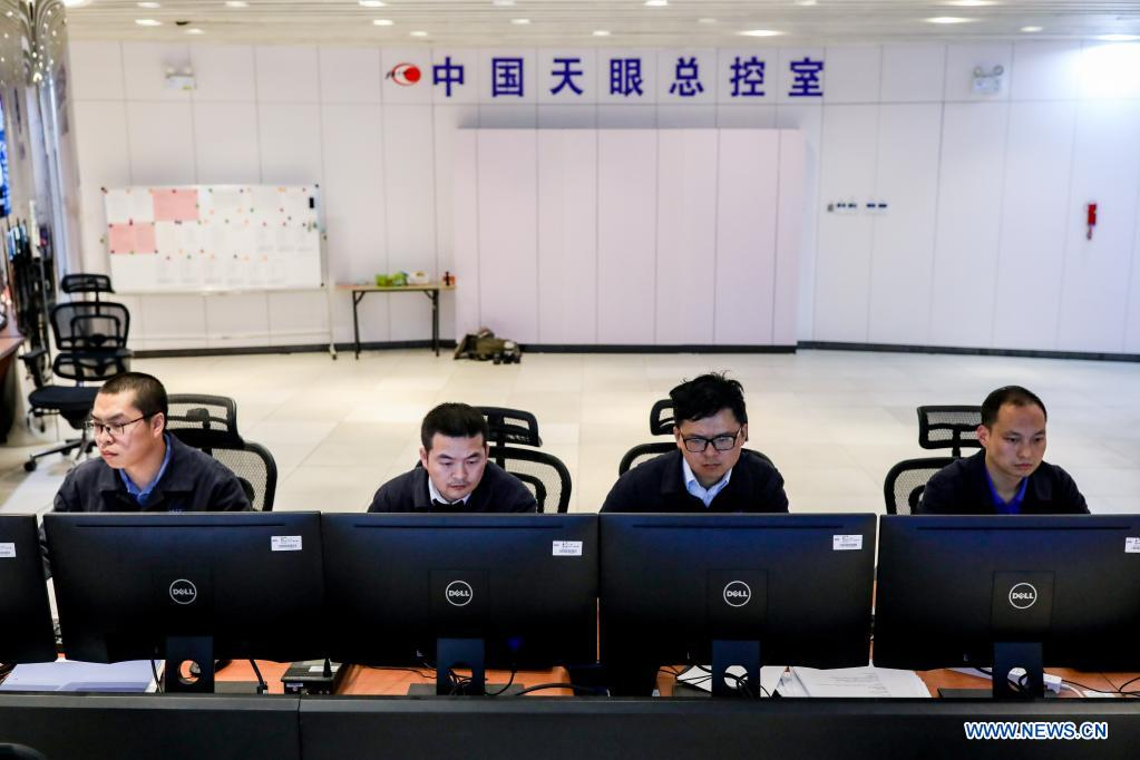 Staff members work at the control room of China's Five-hundred-meter Aperture Spherical Radio Telescope (FAST) in southwest China's Guizhou Province, March 27, 2021. China's FAST officially opened to the world starting Wednesday. (Xinhua/Ou Dongqu)