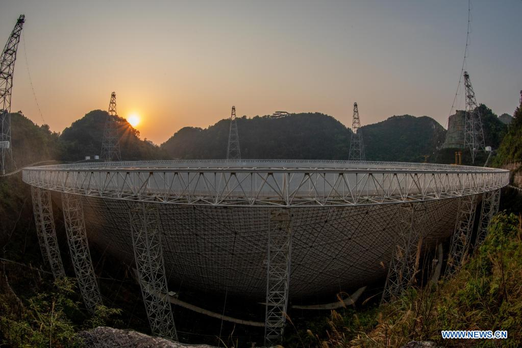 Photo taken on March 29, 2021 shows China's Five-hundred-meter Aperture Spherical Radio Telescope (FAST) under maintenance at sunset in southwest China's Guizhou Province. China's FAST officially opened to the world starting Wednesday. (Xinhua/Ou Dongqu)